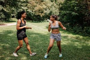 Friends do sports in a park in Munich
